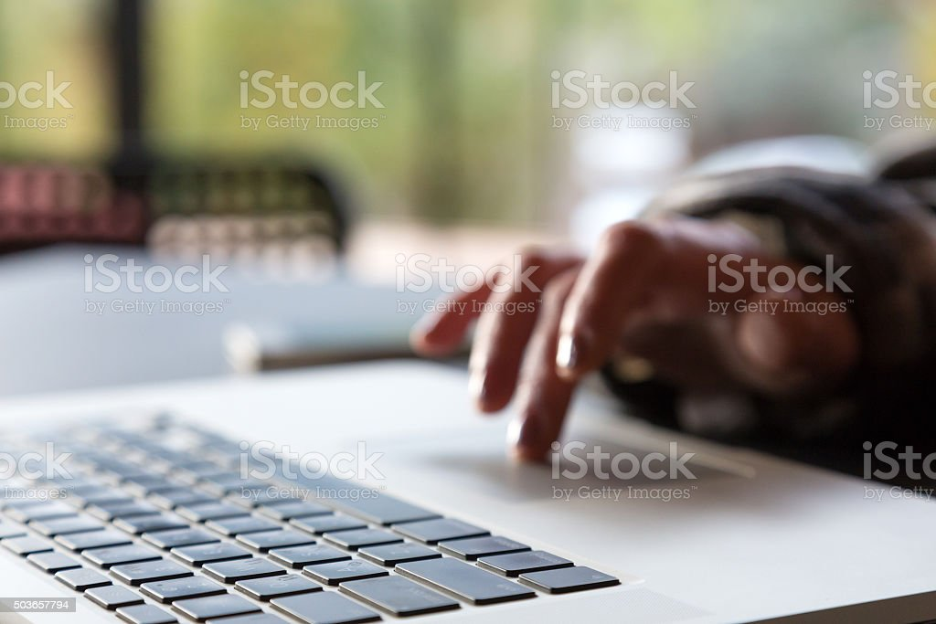 Close up Image of Computer Hand of Person scrolling Touchpad stock photo