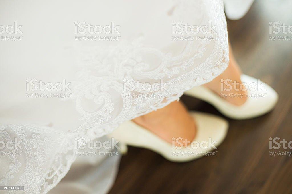 Close up image of elegant floor-length wedding dress stock photo