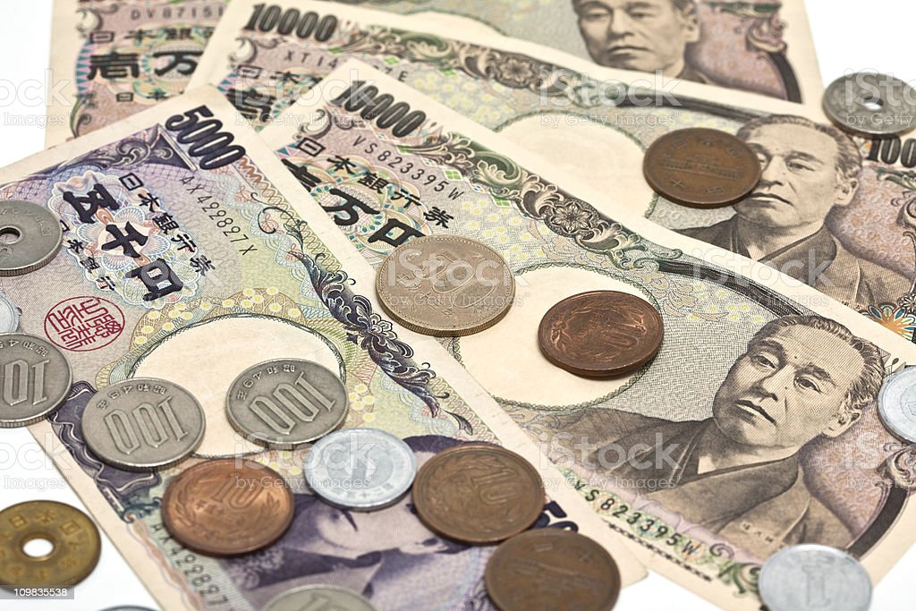 Close up image of Japanese Yen on a white background royalty-free stock photo