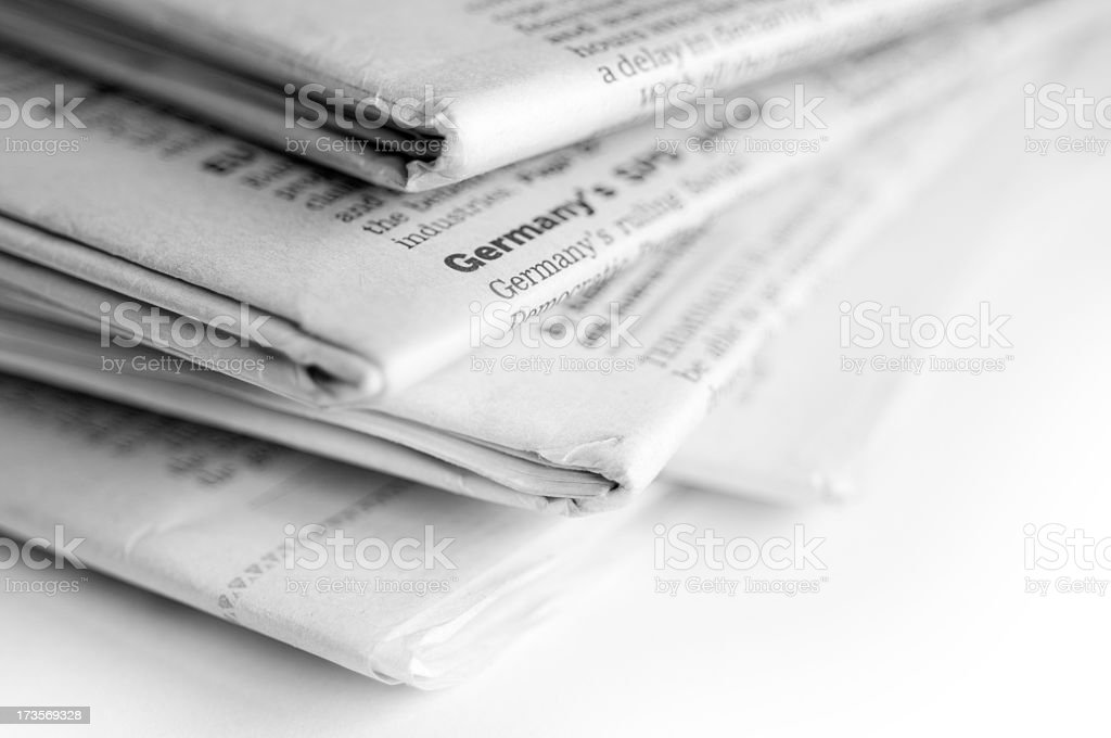 Close up image of newspapers stacked in a pile royalty-free stock photo