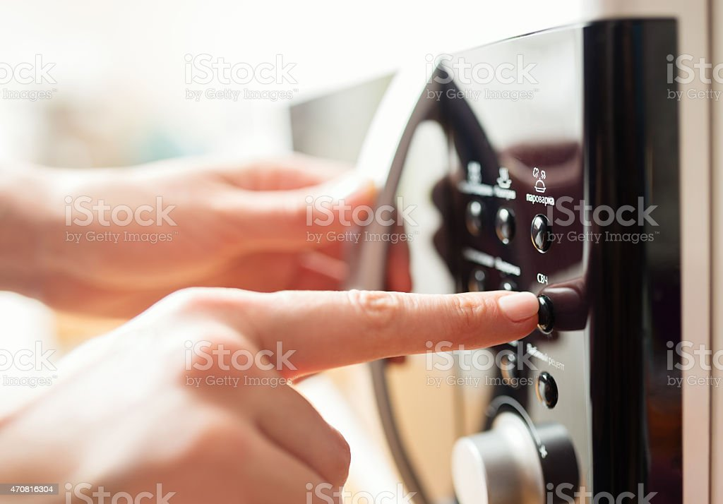 Close up image of operating microwave oven stock photo