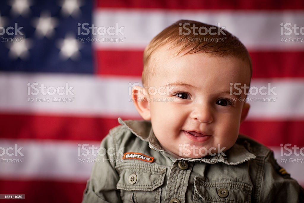 Close Up Image of Patriotic Baby Boy with American Flag royalty-free stock photo