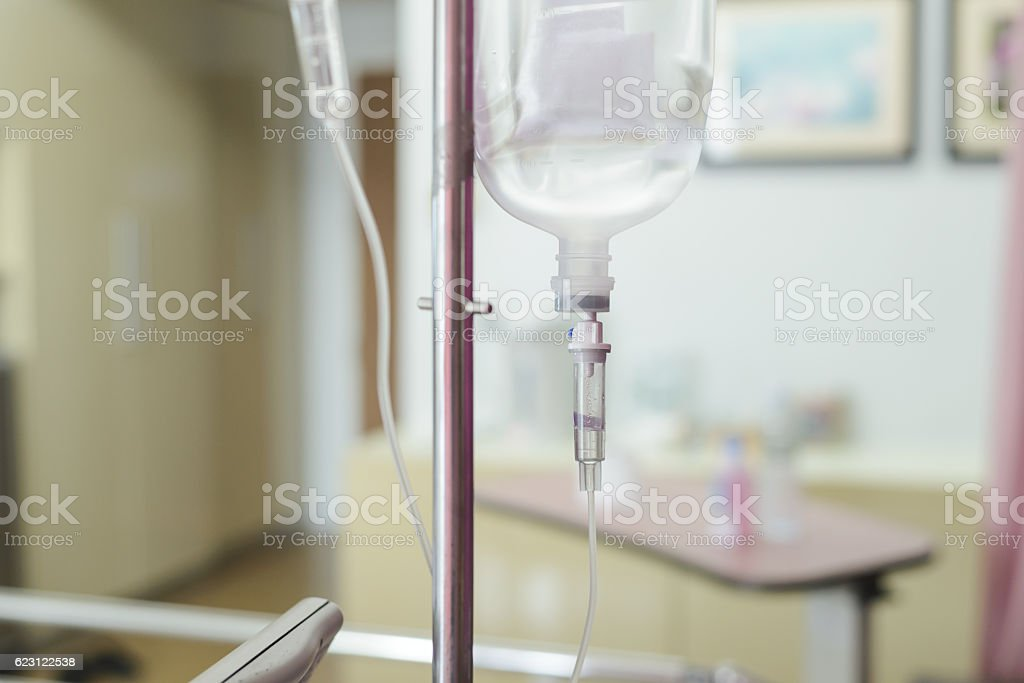 Close up IV saline solution drip for patient in hospital stock photo
