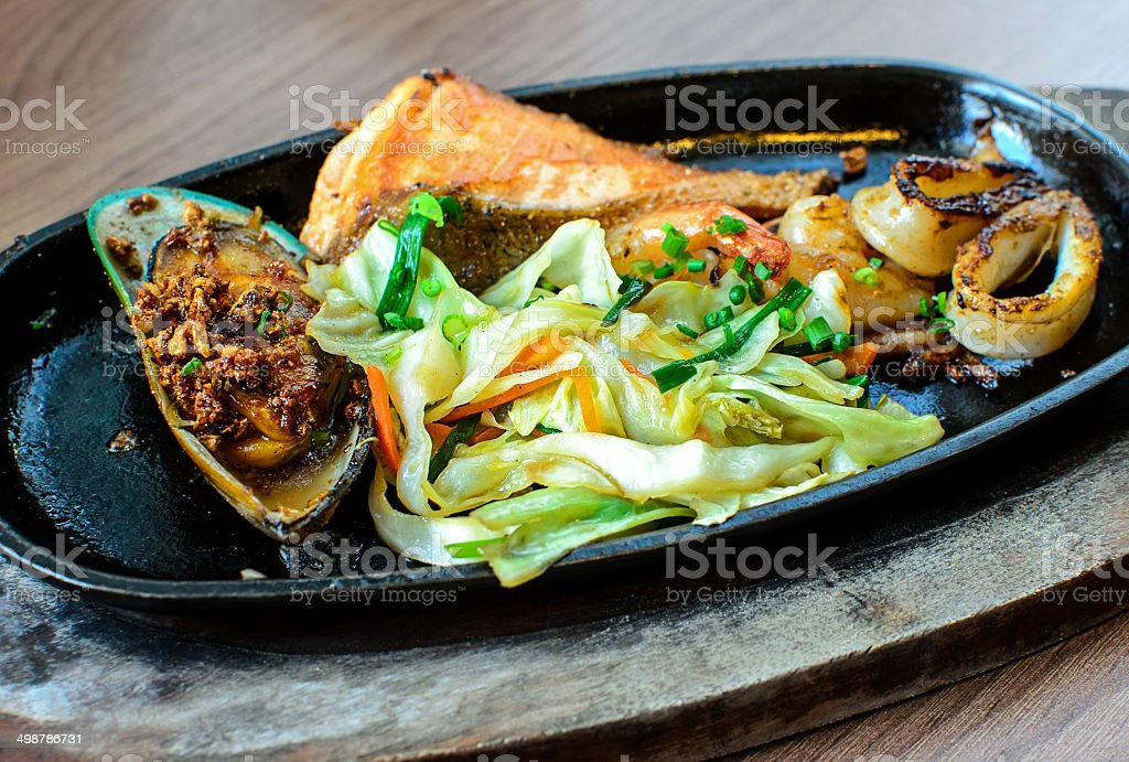 Close up Japanese Seafood Steak Served on Hot Plate, Japanese Cuisine stock photo