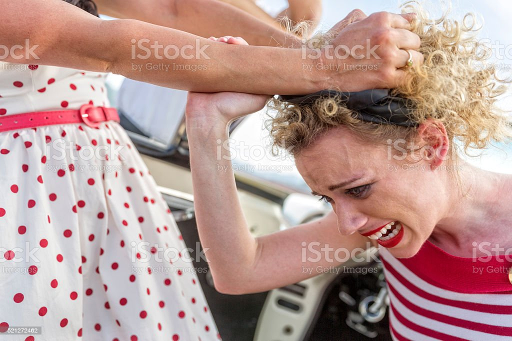 Close Up Jealous Woman Attacks Another Woman Over a Man stock photo