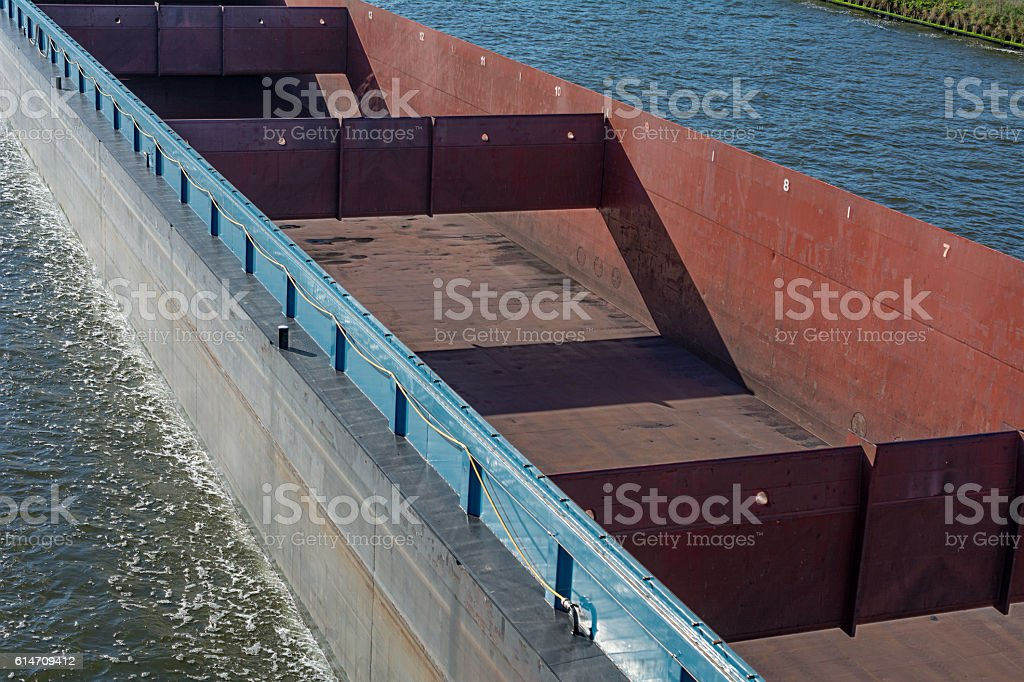 close up large empty cargo hold of freightship in Amsterdam stock photo