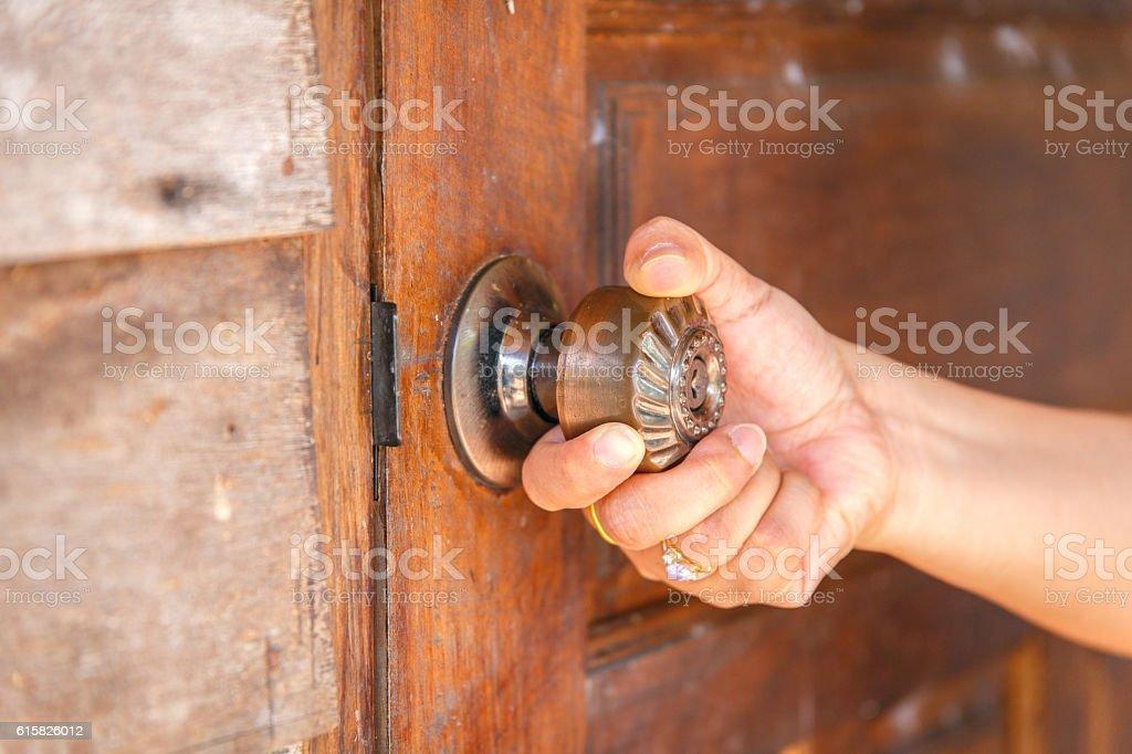 Close up left hand opening the door. stock photo