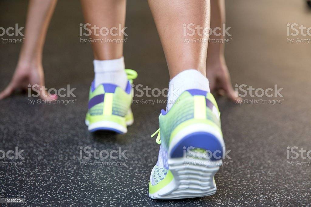 Close up leg of woman runner in starting position stock photo