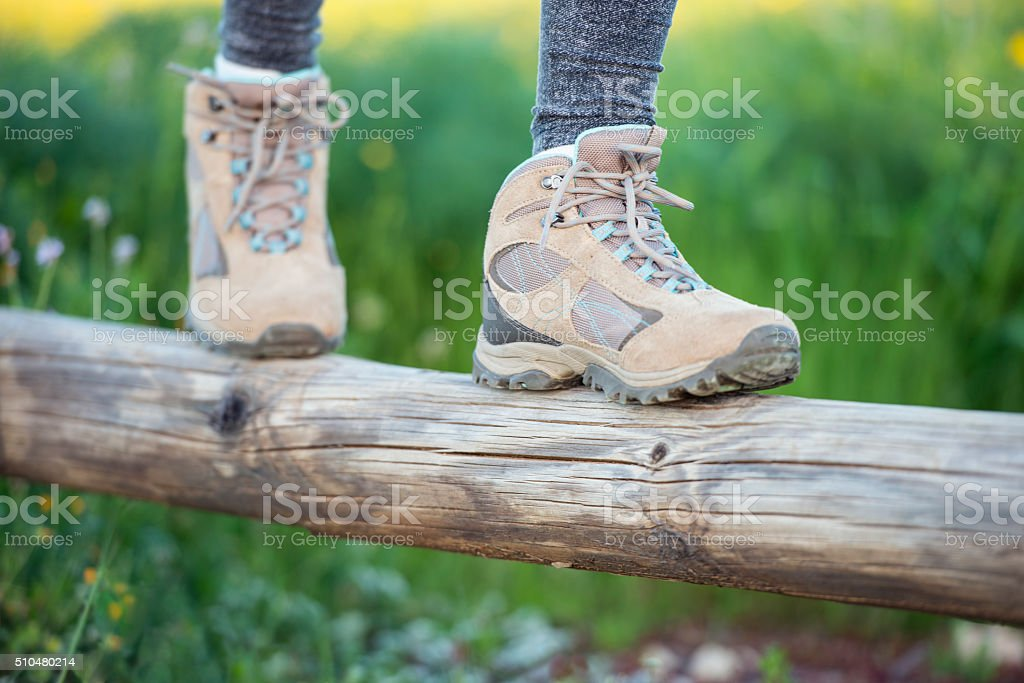 Close up legs of a female hiker. stock photo