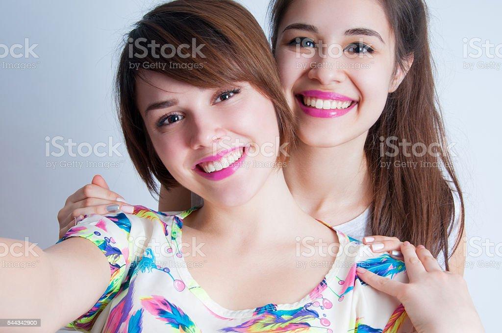 Close up lifestyle selfie portrait of two best friends stock photo