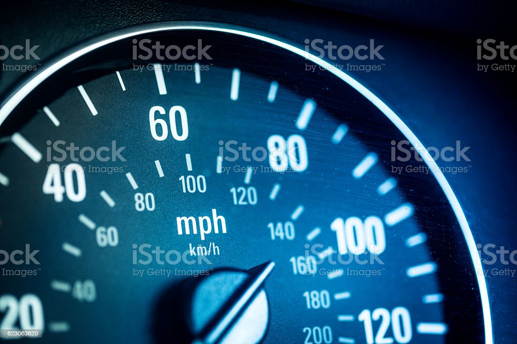 Close up macro image of blue car speedometer stock photo