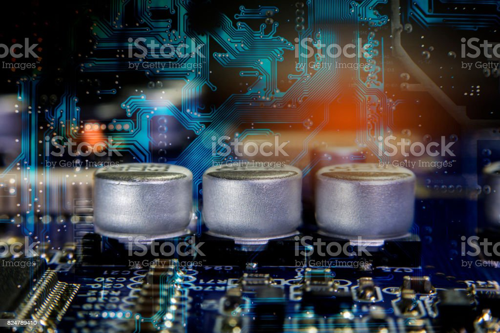 Close up macro of aluminum electrolytic capacitors stock photo