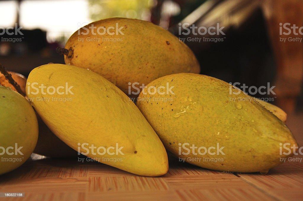 close up mango, native tropical fruit at open Thailand market royalty-free stock photo