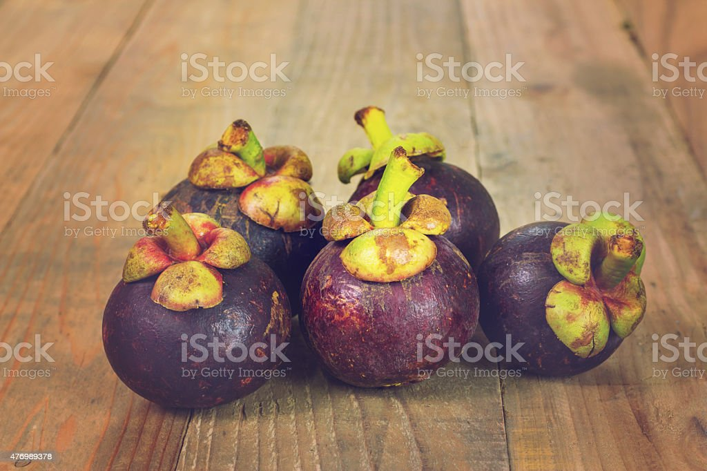 Close up mangosteen fruit on wooden background, Vintage effect royalty-free stock photo