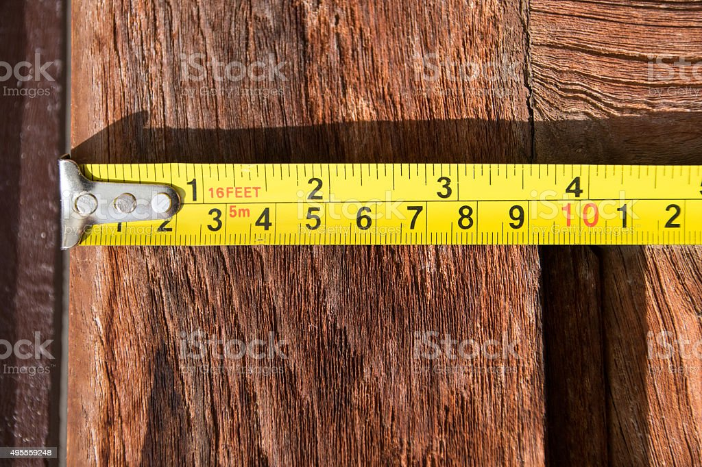 Close up Measuring Tape on wood background stock photo