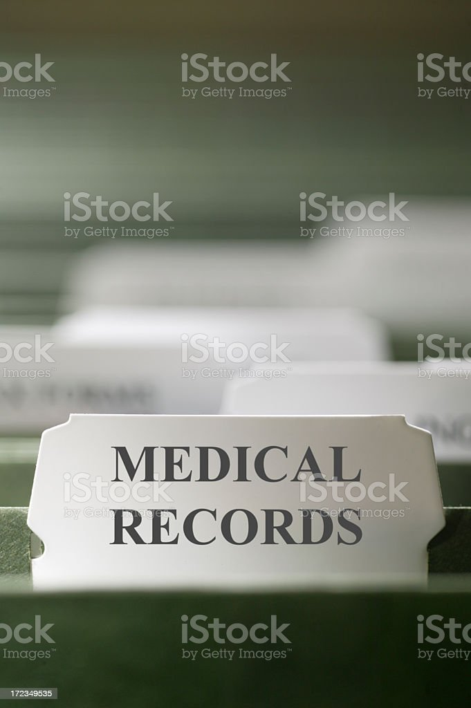 Close up Medical Records File Folder Tab in File Cabinet stock photo