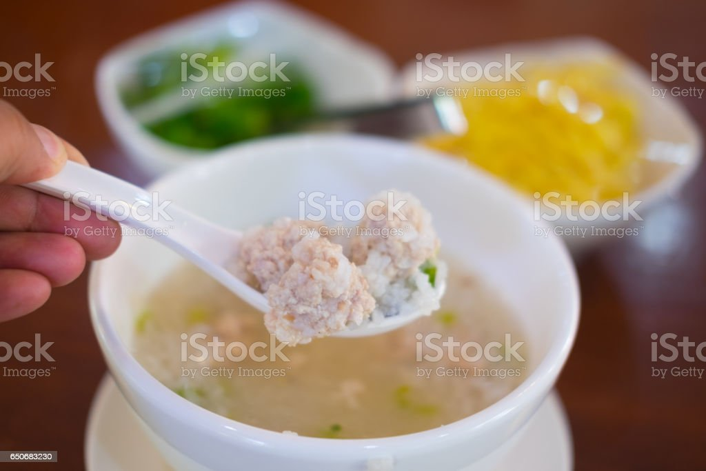 Close up minced pork on white spoon soft boiled rice stock photo