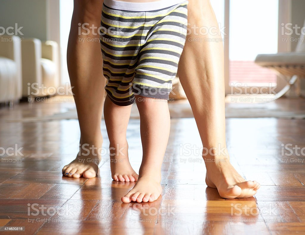 Close up mother and little boy walking stock photo