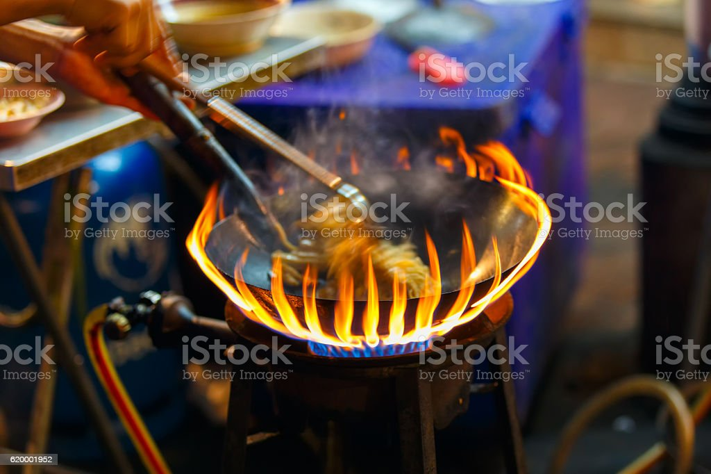 Close up movement the hand a man worker Pad Thai stock photo