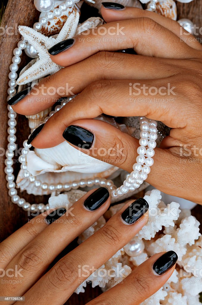 close up nails with manicure among sea stuff, shell, coral stock photo