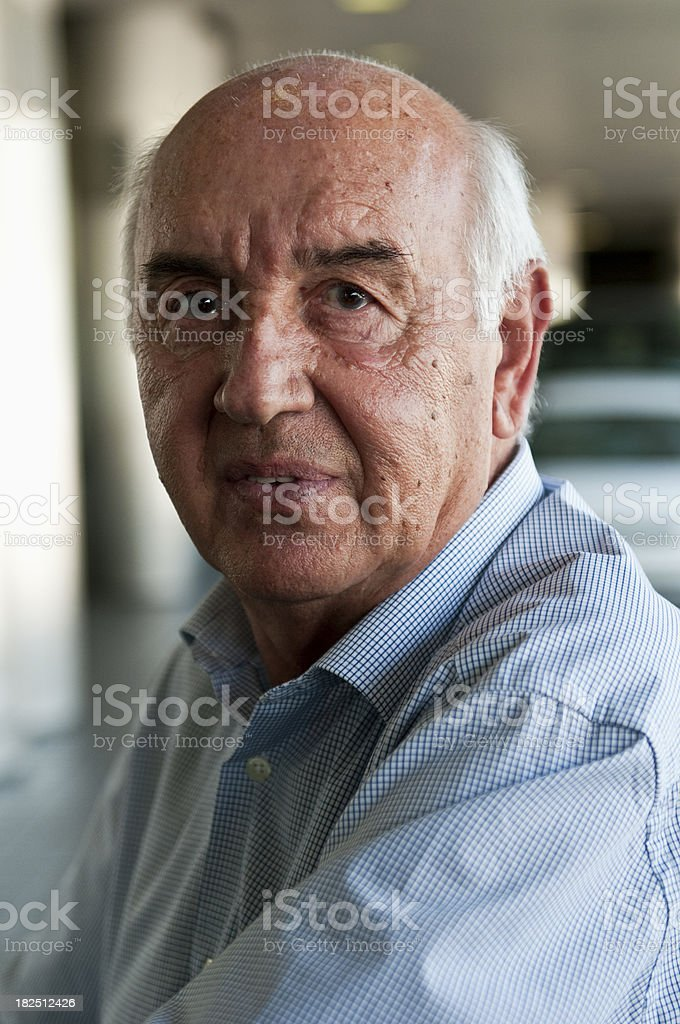 Close up of a bald senior with a blue shirt royalty-free stock photo
