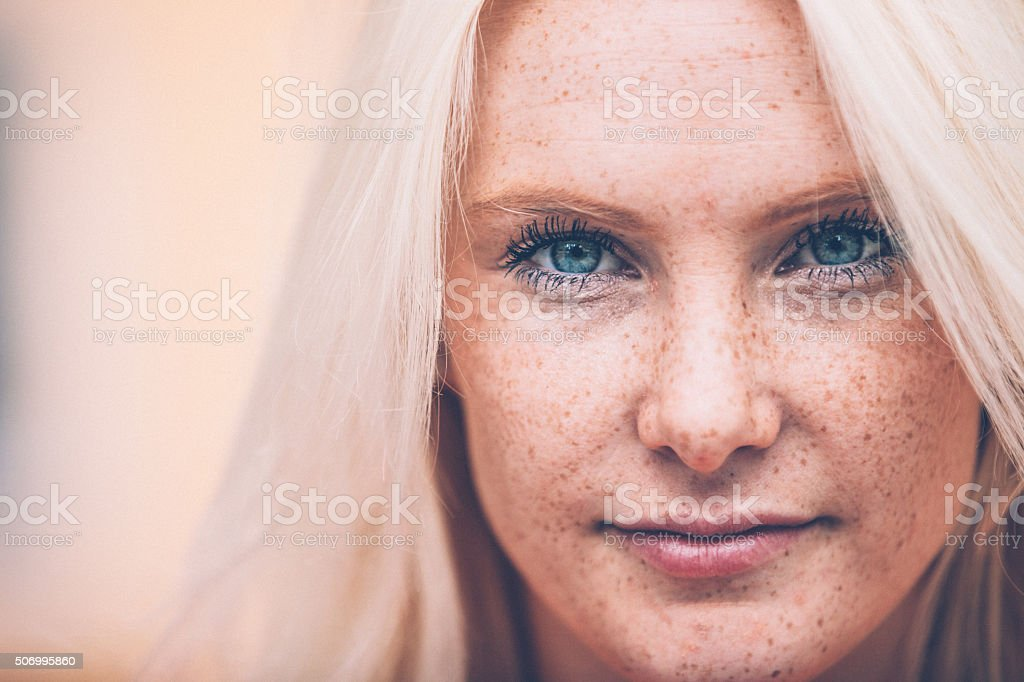 Close up of a Beautiful Blonde Woman with Freckles Outdoors stock photo