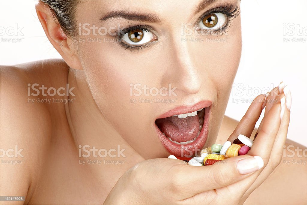 close up of a beautiful girl having pills royalty-free stock photo