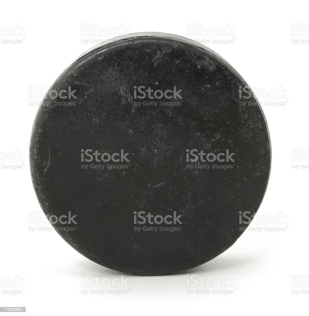 Close up of a black hockey puck stock photo