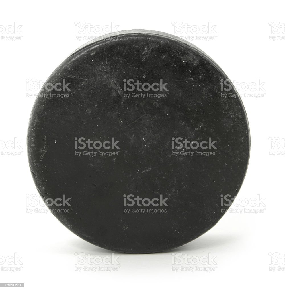 Close up of a black hockey puck stock photo