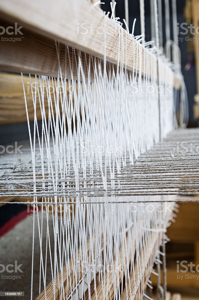 Close Up Of a Blanket Being Woven On Loom royalty-free stock photo