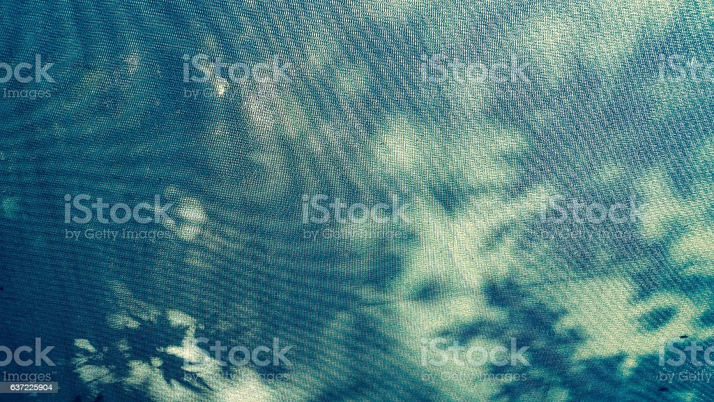 Close up of a blue canopy fabric under the sun stock photo