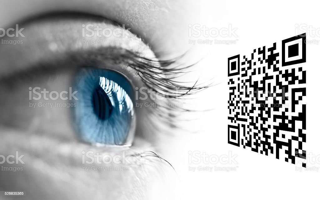 Close up of a blue eye and QR code stock photo