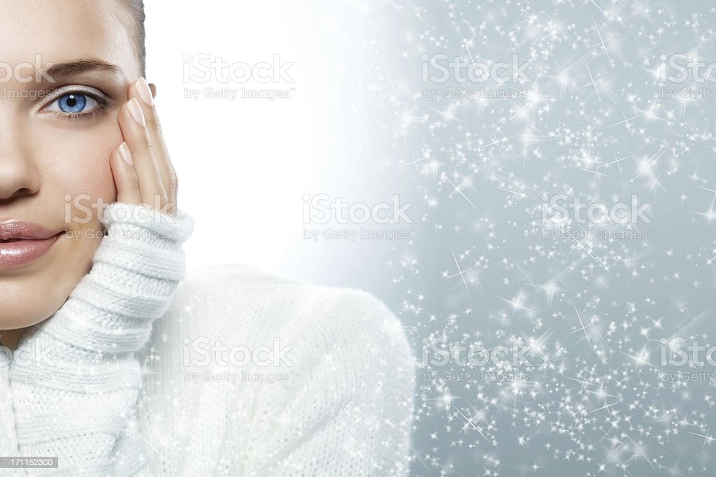 Close up of a blue eyed woman in a white sweater royalty-free stock photo