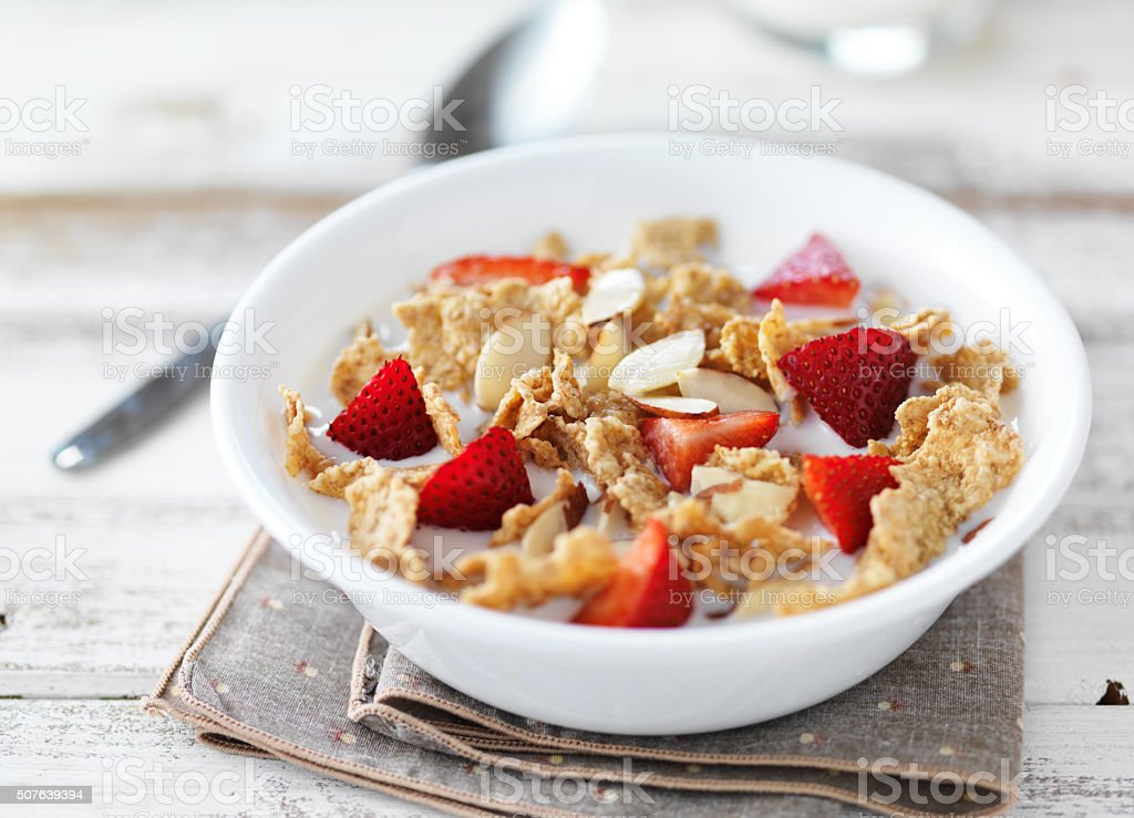 close up of a bowl of cereal and milk stock photo