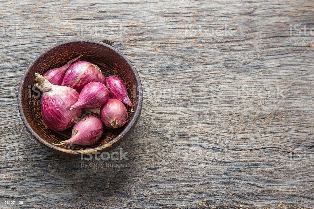 close up of a bowl of shallots stock photo