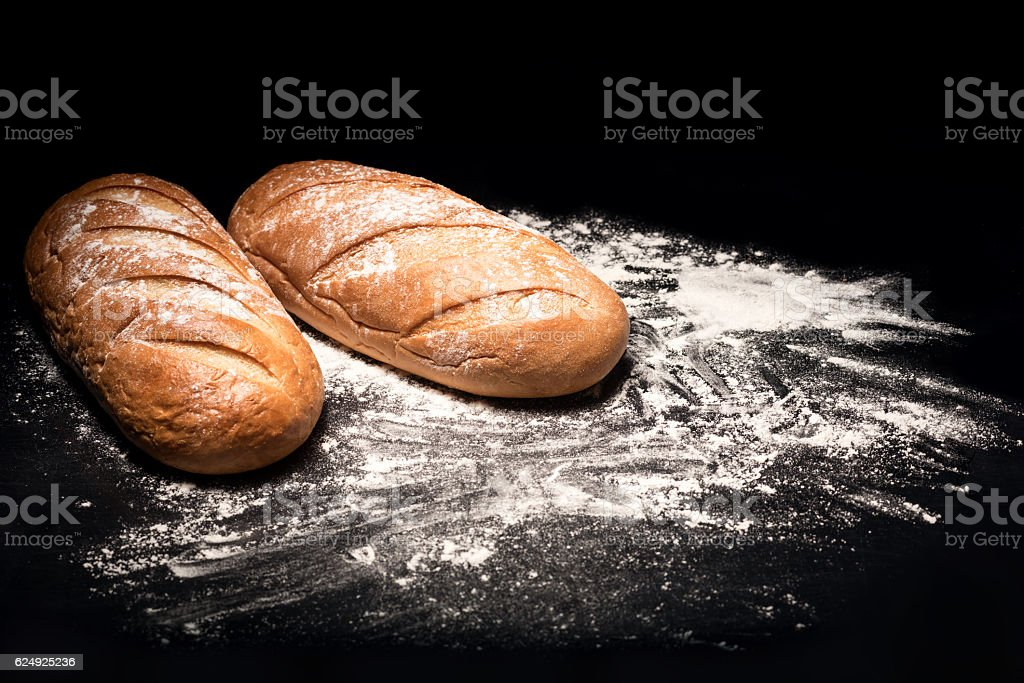 Close up of a bread lying on  cutting board stock photo