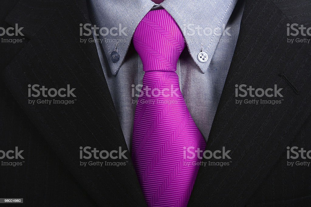 Close up of a bright fuchsia tie under a black suit royalty-free stock photo