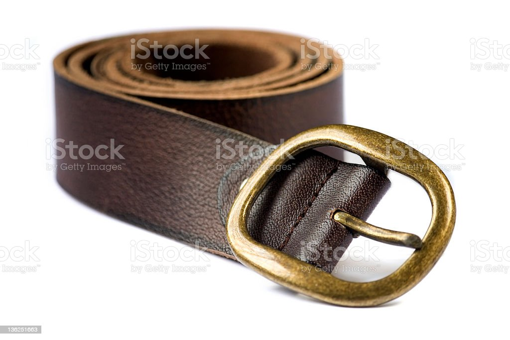 A close up of a brown leather belt with golden buckle royalty-free stock photo