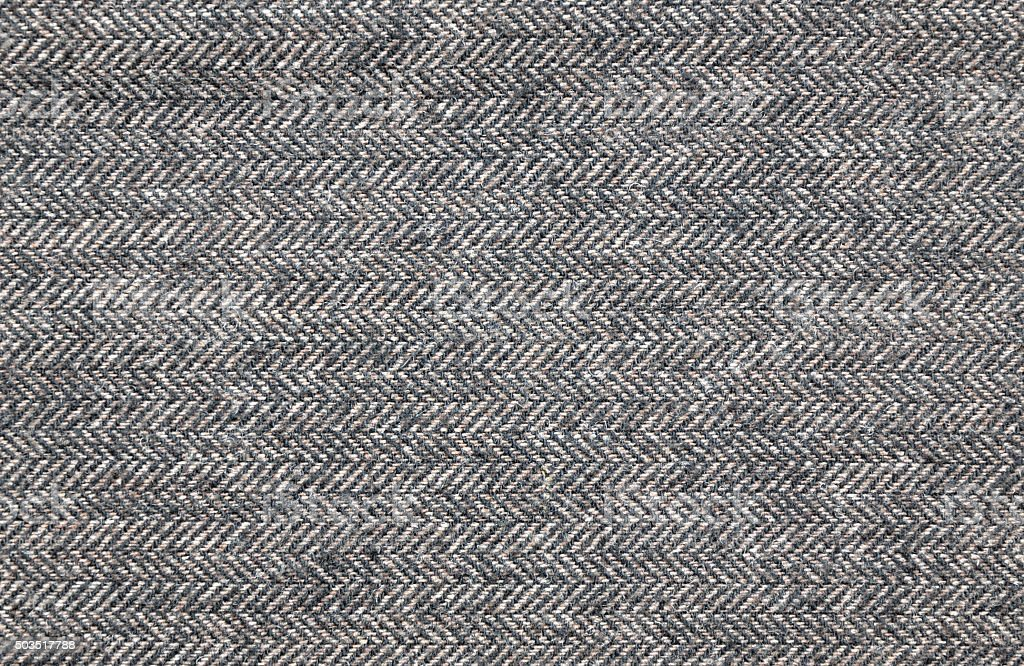 Close up of a brown tweed fabric stock photo