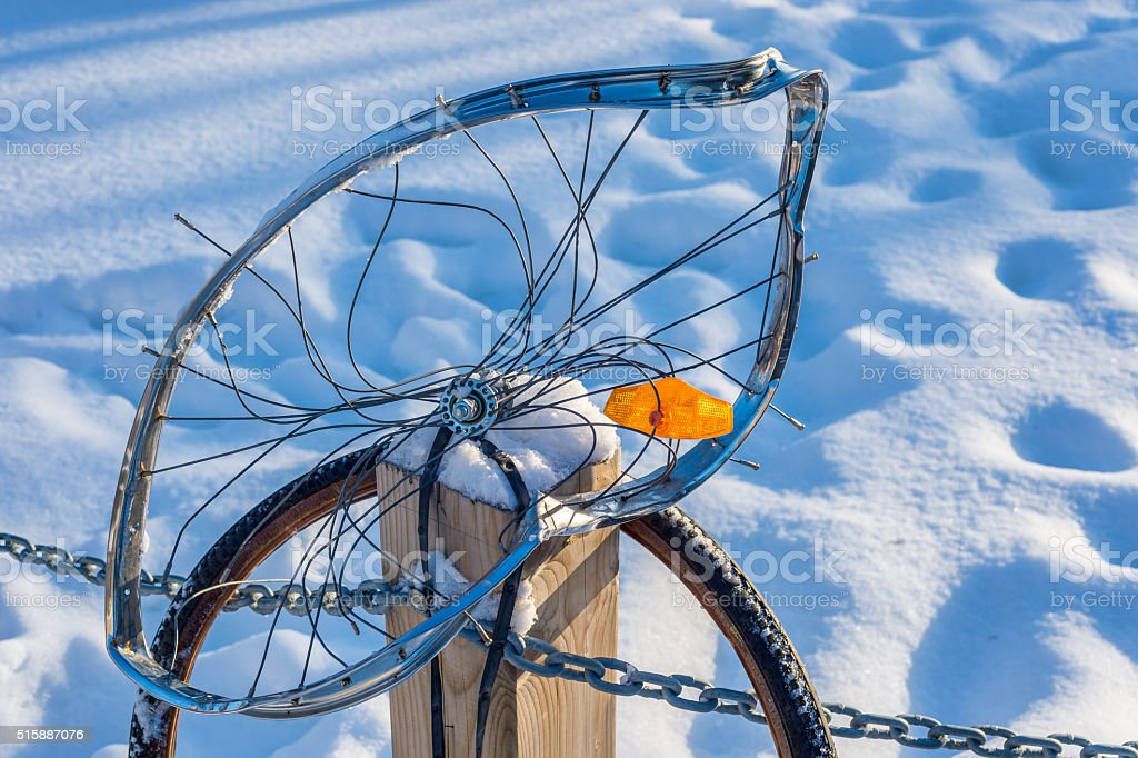 Close up of a buckled bike wheel stock photo