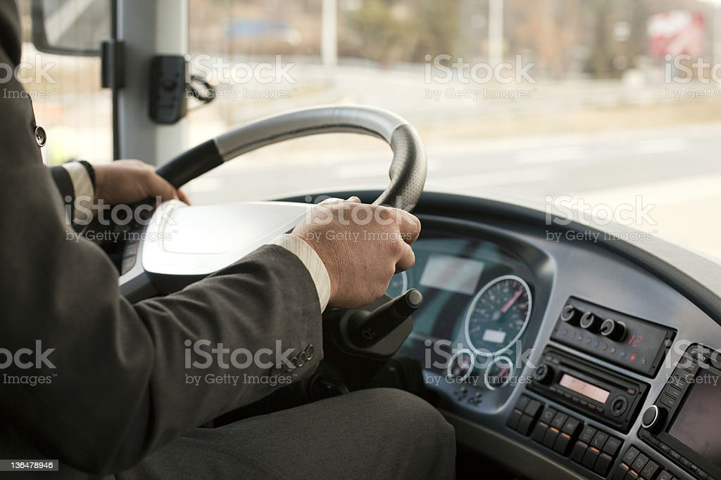 Close up of a bus driver going down the road stock photo