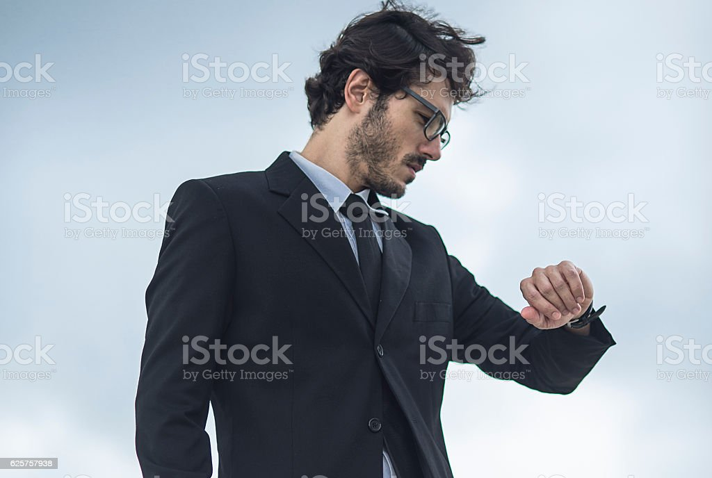close up of a businessman checking what is the time stock photo