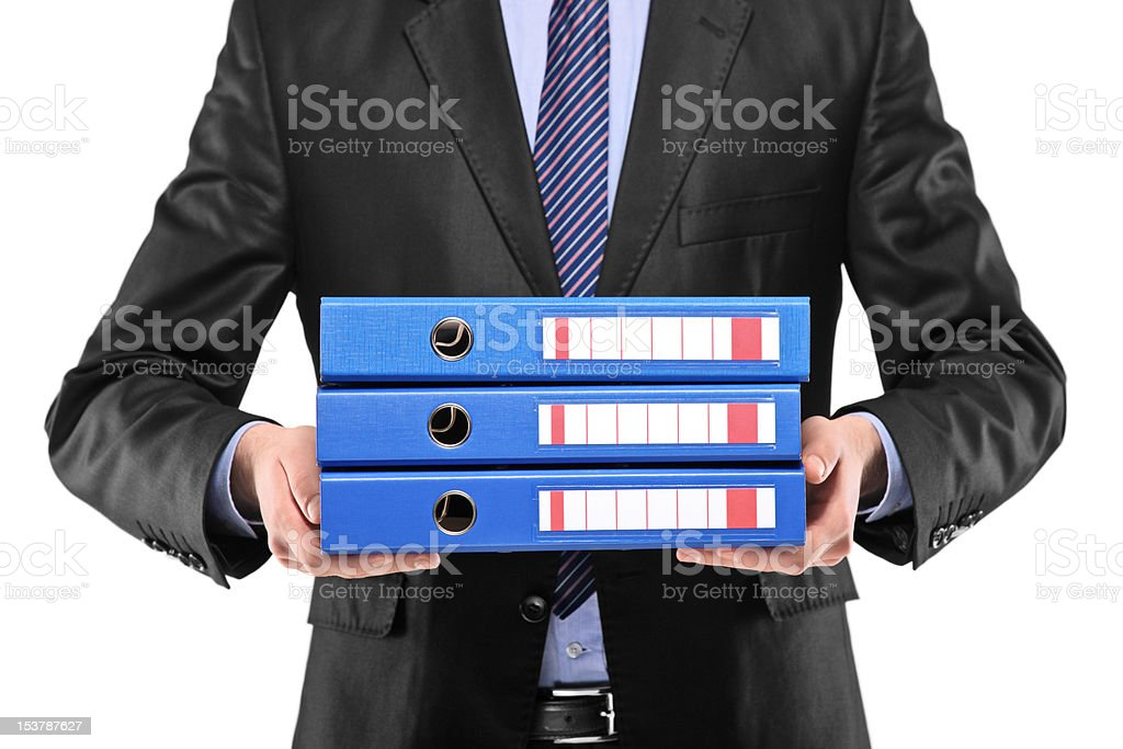 Close up of a businessman holding folders stock photo