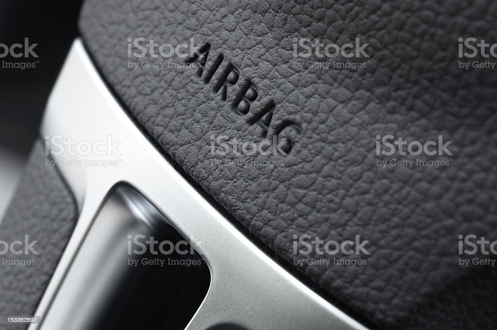 close up of a car steering wheel airbag stock photo