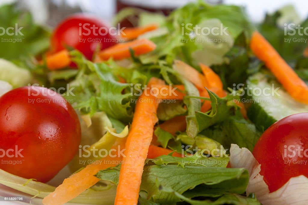 Close up of a carrot and tomato salad stock photo