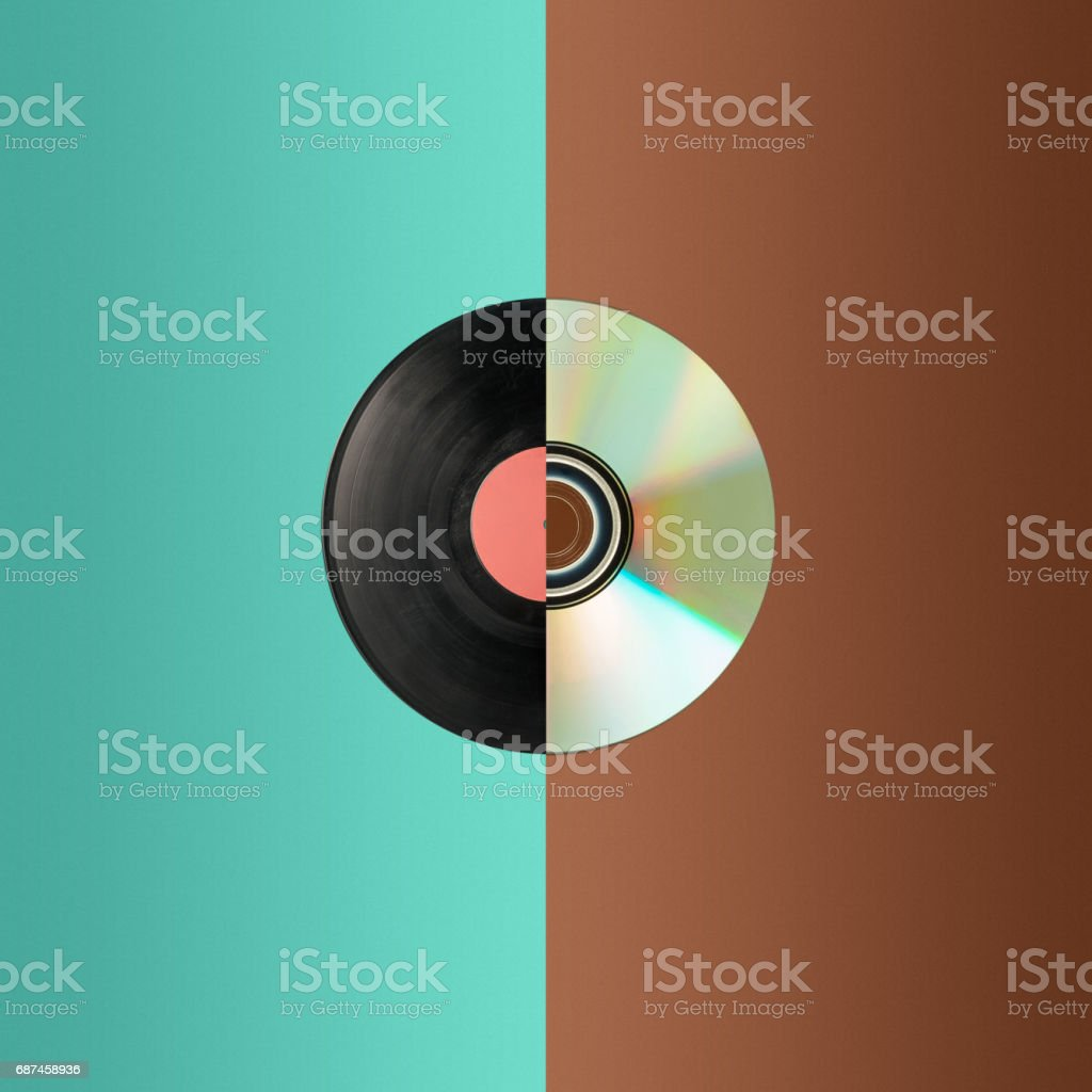 Close up of a cd and partial vinyl record stock photo