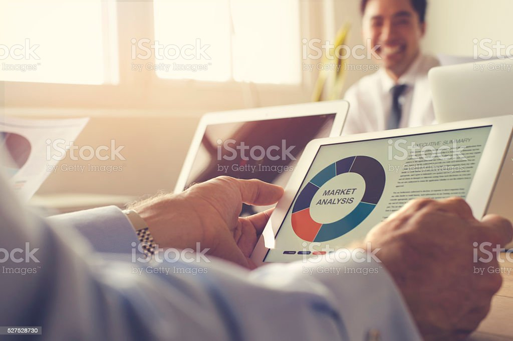Close up of a chart on a digital tablet. stock photo