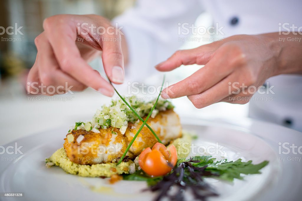 Close up of a Chef decorating a plate stock photo