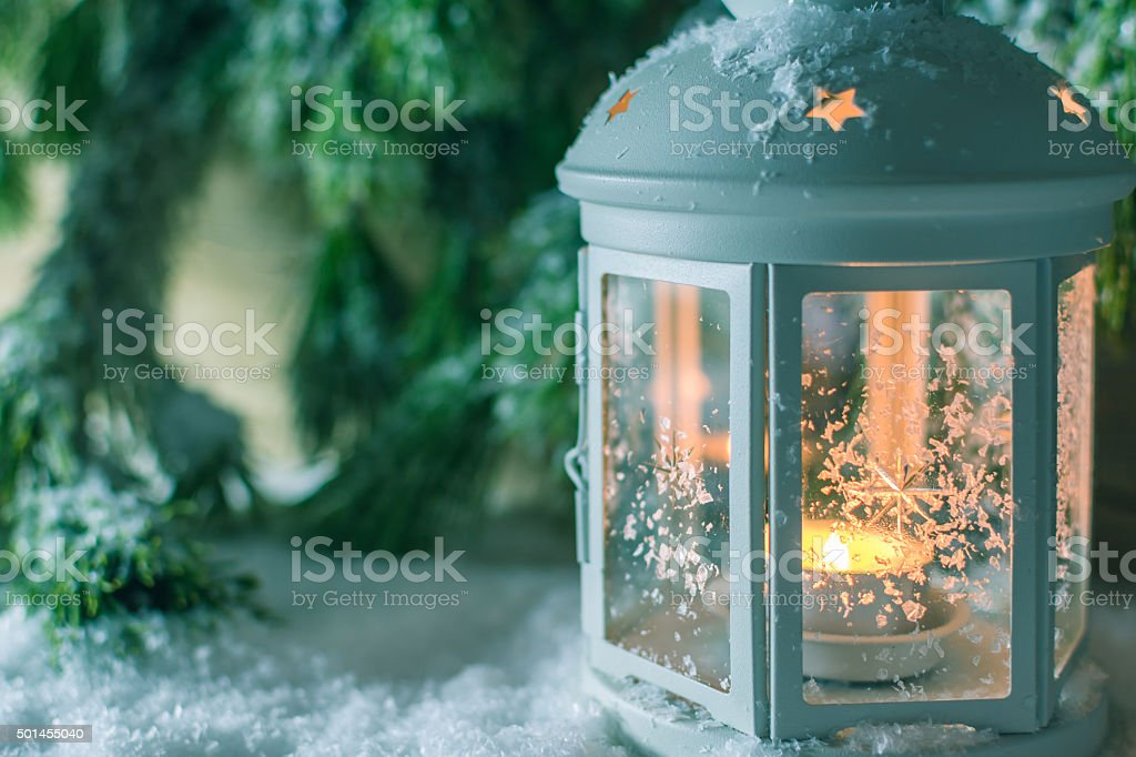 Close Up of a Christmas Lantern in Snow stock photo