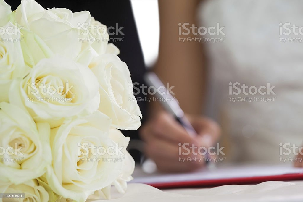 Close up of a classy couple signing wedding register stock photo
